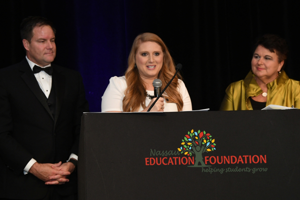Autumn Nicks accepts the 2017 Teacher of the Year award from the Nassau Education Foundation. Pictured are Autumn Nicks, Aaron bean, and Kathy Burns.